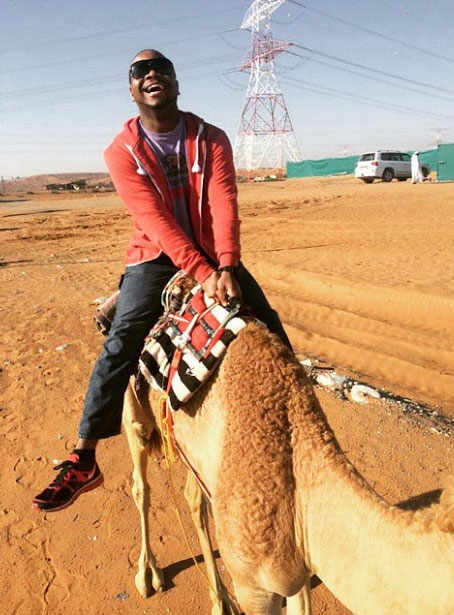 guy riding camel