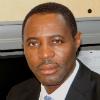 Dr.  Claude Tameze